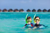 Happy father and son snorkeling in a tropical ocean