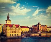 Vintage retro hipster style travel image of Prague Stare Mesto embankment view from Charles bridge o