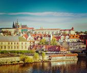 Vintage retro hipster style travel image of Mala Strana and  Prague castle over Vltava river. Prague, Czech Republic