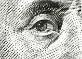 Eye of Benjamin Franklin on 100 dollar bill