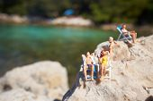 Miniature figurine an a beach in swimming costume