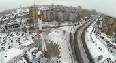 RUSSIA, SAMARA - JAN 4, 2014: Aerial view to monument rocket stands at mountain top against city lan