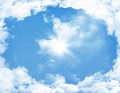 Blue sky with clouds and sun background