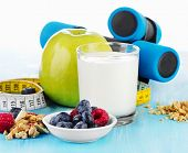 Dumbbells With  Healthy Food And Drink On Blue Background
