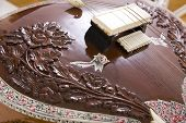 foto of string instrument  - Sitar a string Traditional Indian musical instrument close - JPG