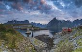 Picturesque Red Fishing Hut On The Coast Of Fjord On Lofoten