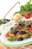Spaghetti Alla Puttanesca With Olives And Anchovies