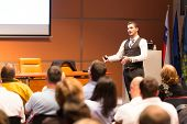 stock photo of entrepreneurship  - Speaker at Business Conference and Presentation. Audience at the conference hall. Business and Entrepreneurship.