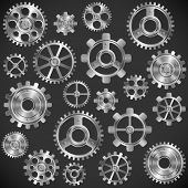 pic of bicycle gear  - Collection of shiny metal gears on dark background - JPG