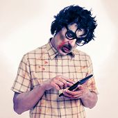a scary hipster zombie using a tablet computer, with a filter effect