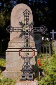 old grave with iron cross