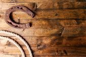 stock photo of lasso  - American West still life with old horseshoe and cowboy lasso - JPG