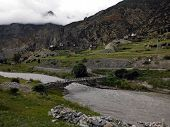 Wooden Bridge Over A Himalayan River