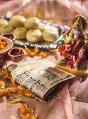 Indian rupees bank notes in Diwali puja with a Goddess of wealth -laxmi