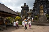 BALI, INDONESIA - SEPTEMBER 20, 2014: Tourists and devotees visit the Besakih Temple Complex, the largest and most important Hindu temple on Bali Island.