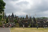 BALI, INDONESIA - SEPTEMBER 20, 2014: Tourists and devotees visit the Besakih Temple Complex, the largest and most important Hindu temple in Bali. Many significant religious events are held here.