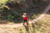 The Girl Runs On A Footpath
