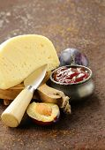 cheese board plate with plums jam and fresh fruit