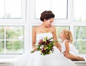 Smiling Happy Bride And A Flower Indoors