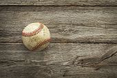 Old Baseball On Rough Wood Surface