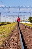 Woman Walking Away Railroad Track