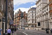 LONDON, UK - JUNE 3, 2014: Harrods department store, shopping and restaurants tourists point.