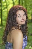 foto of wench  - Portrait of young girl with trees in the background - JPG