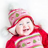 Happy Laughing Baby Girl In A Red Dress With Christmas Hat