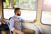 Hipster business man on tram