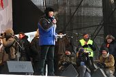 Leading Vladimir Ryzhkov on the stage of opposition rally