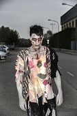 One Male Zombie Standing In Empty City Street On Halloween