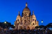 Basilica Of The Sacre Coeur On Top Of Montmartre Hill In Paris, France