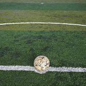 Old Soccer Ball On New Artificial Turf