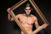 pic of beast-man  - fashion studio portrait of sexy muscular man with naked chest and bright painted face - JPG