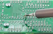 The Solder Electronics Pcb With The Soldering Iron
