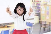 Adorable Girl In Kindergarten Class