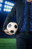 Entrepreneur Holding Soccer Ball