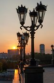 stock photo of ekaterinburg  - Yekaterinburg town throw the street lights in the sunset