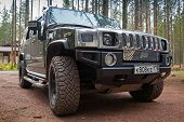 Black Hummer H2 Car Stands On Dirty Country Road