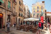 Street View With Walking Tourists. Tarragona, Spain