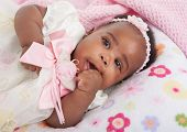 happy big smiling 6-month old African American baby girl portrait