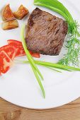 meat savory : grilled beef fillet mignon on white plate with tomatoes apples and pepper over wooden