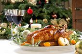 stock photo of roast duck  - Citrus glazed roasted duck stuffed with rice garnished with apples kumquats and sage - JPG