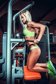 attractive woman in gym on workout machine