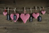 Greeting card with red checked hearts and good wishes.