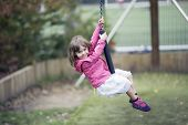 Little Girl Playing In The Zip