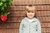 Outdoor portrait of adorable little boy