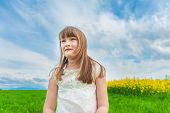 Outdoor portrait of a cute little girl in a countryside