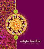 foto of rakhi  - Beautiful rakhi with gems on shiny red and beige background for the festival of Raksha Bandhan celebrations - JPG