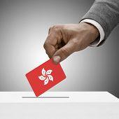 Black Male Holding Flag. Voting Concept - Hong Kong